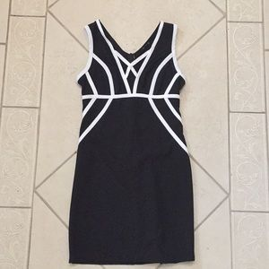 Black dress with white piping and deep mesh front